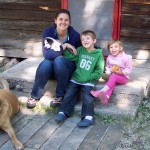 "Amy and the ""kids"" outside the cabin"
