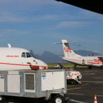 Planes with Tahitian mountains in the background